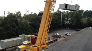 large commercial hvac unit being lifted by a crane